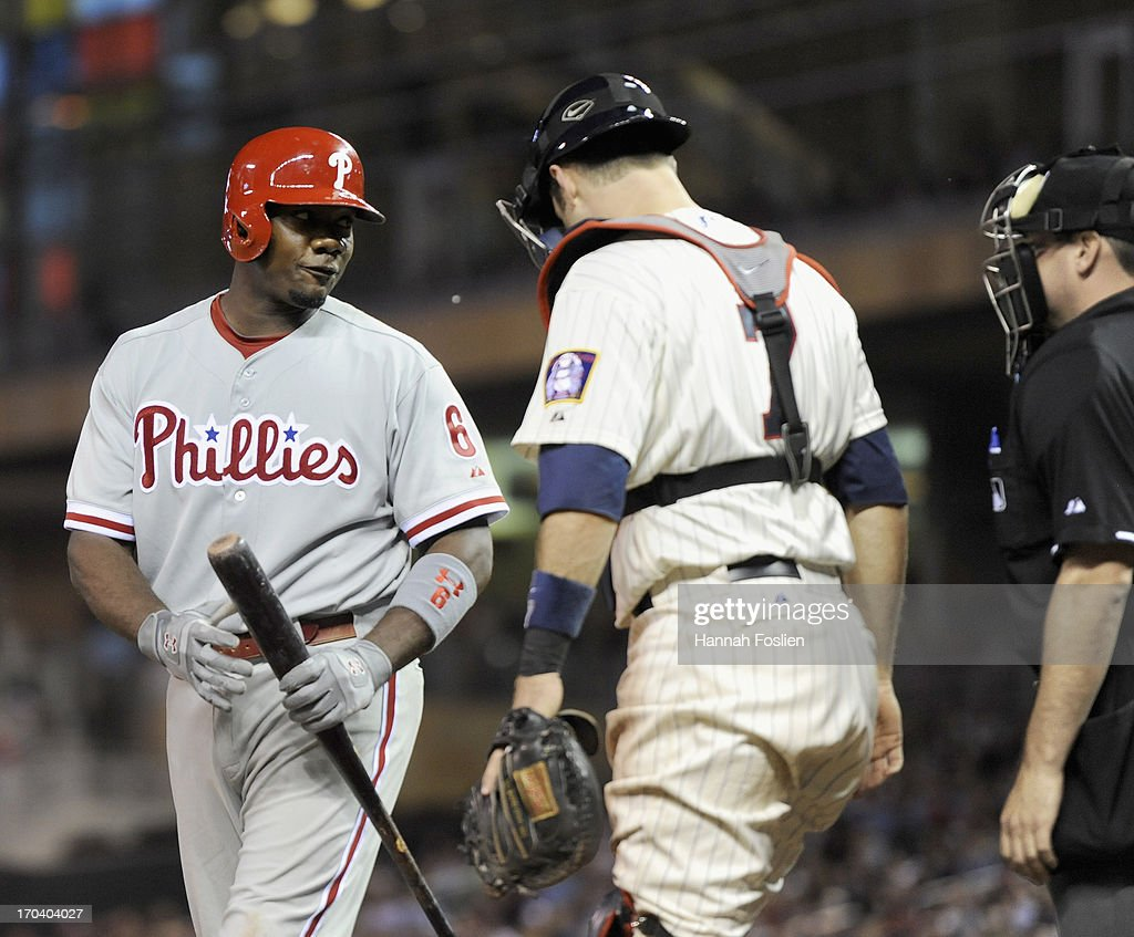 Ryan Howard #6 of the Philadelphia Phillies argues with home plate umpire David Rackley #86 after a called third strike as Joe Mauer #7 of the Minnesota Twins looks on during the eighth inning of the game on June 12, 2013 at Target Field in Minneapolis, Minnesota. The Twins defeated the Phillies 4-3.