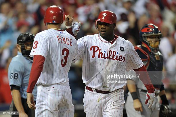 Ryan Howard of the Philadelphia Phillies celebrates with Hunter Pence after hitting a threerun home run in the sixth inning of Game One of the...