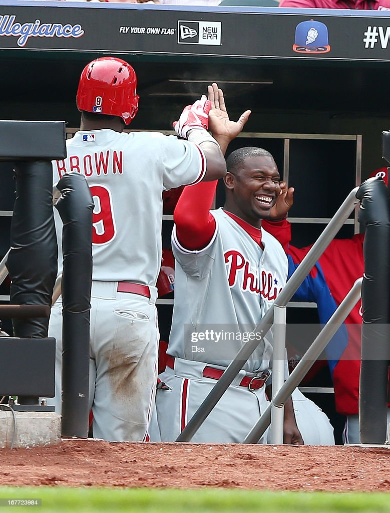 Ryan Howard #6 of the Philadelphia Phillies congratulates teammate Domonic Brown #9 after Brown scored a run in the eighth inning against the New York Mets on April 28, 2013 at Citi Field in the Flushing neighborhood of the Queens borough of New York City.
