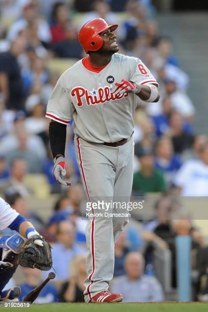 Ryan Howard of the Philadelphia Phillies eyes the flight of the ball as he flies out to left field in the second inning of Game One of the NLCS...