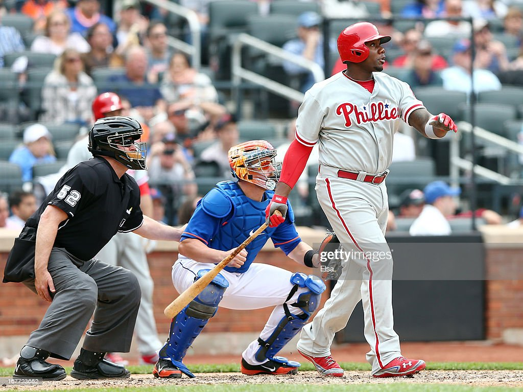 Ryan Howard #6 of the Philadelphia Phillies hits a 2 RBI double in the seventh inning as John Buck #44 of the New York Mets catches on April 28, 2013 at Citi Field in the Flushing neighborhood of the Queens borough of New York City.