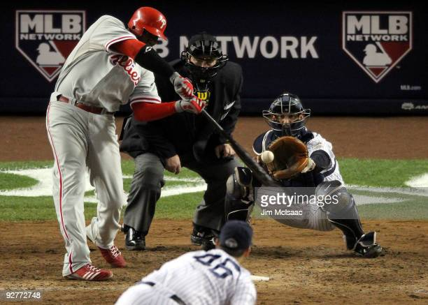 Ryan Howard of the Philadelphia Phillies hits a 2run home run in the top of the sixth inning against Andy Pettitte of the New York Yankees in Game...