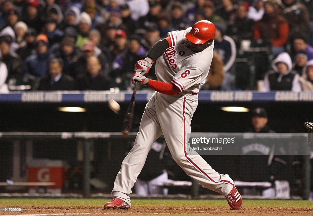 Ryan Howard #6 of the Philadelphia Phillies hits a go ahead RBI sacrifice fly against the Colorado Rockies in the top of the ninth inning to give the Phillies a 6-5 lead in Game Three of the NLDS during the 2009 MLB Playoffs at Coors Field on October 11, 2009 in Denver, Colorado.
