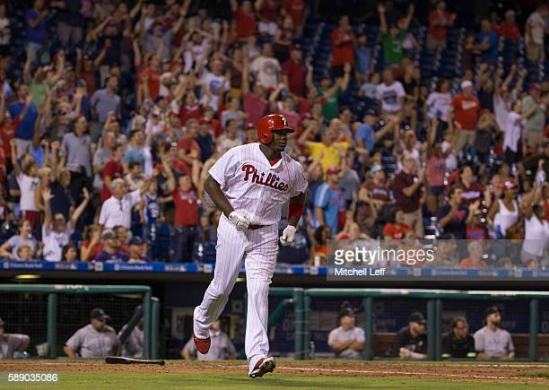 Ryan Howard of the Philadelphia Phillies hits a grand slam in the bottom of the fifth inning against the Colorado Rockies at Citizens Bank Park on...