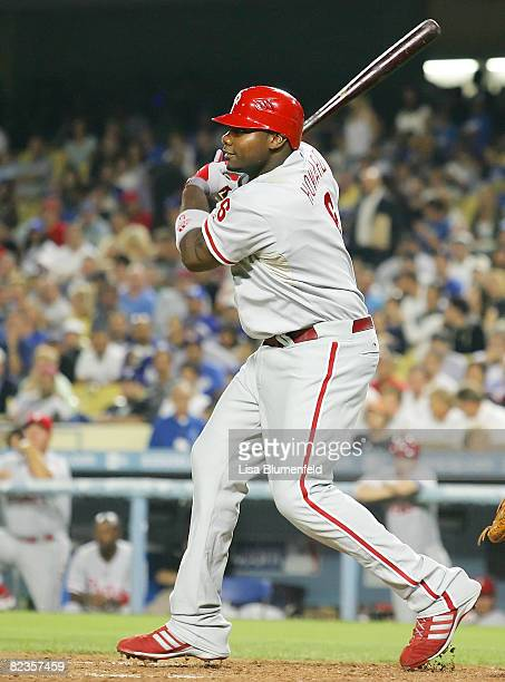 Ryan Howard of the Philadelphia Phillies hits a RBI sacrifice in the seventh inning against the Los Angeles Dodgers at Dodger Stadium on August 14...