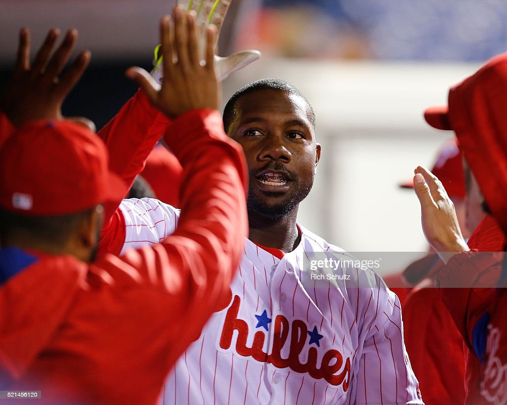 Ryan Howard of the Philadelphia Phillies is congratulated by teammates after he hit a home run in the ninth inning against the Washington Nationals in an MLB game won by the Nationals 9-1 at Citizens Bank Park on April 15, 2016 in Philadelphia, Pennsylvania. All players are wearing #42 in honor of Jackie Robinson.