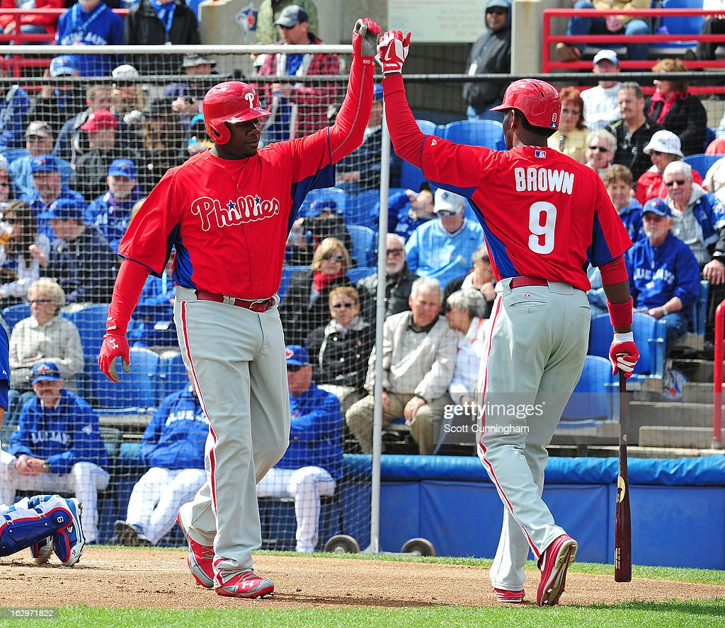 Ryan Howard #6 of the Philadelphia Phillies is congratulated by Domonic Brown #9 after hitting a first inning home run during a spring training game against the Toronto Blue Jays at Florida Auto Exchange Stadium on March 2, 2013 in Dunedin, Florida.