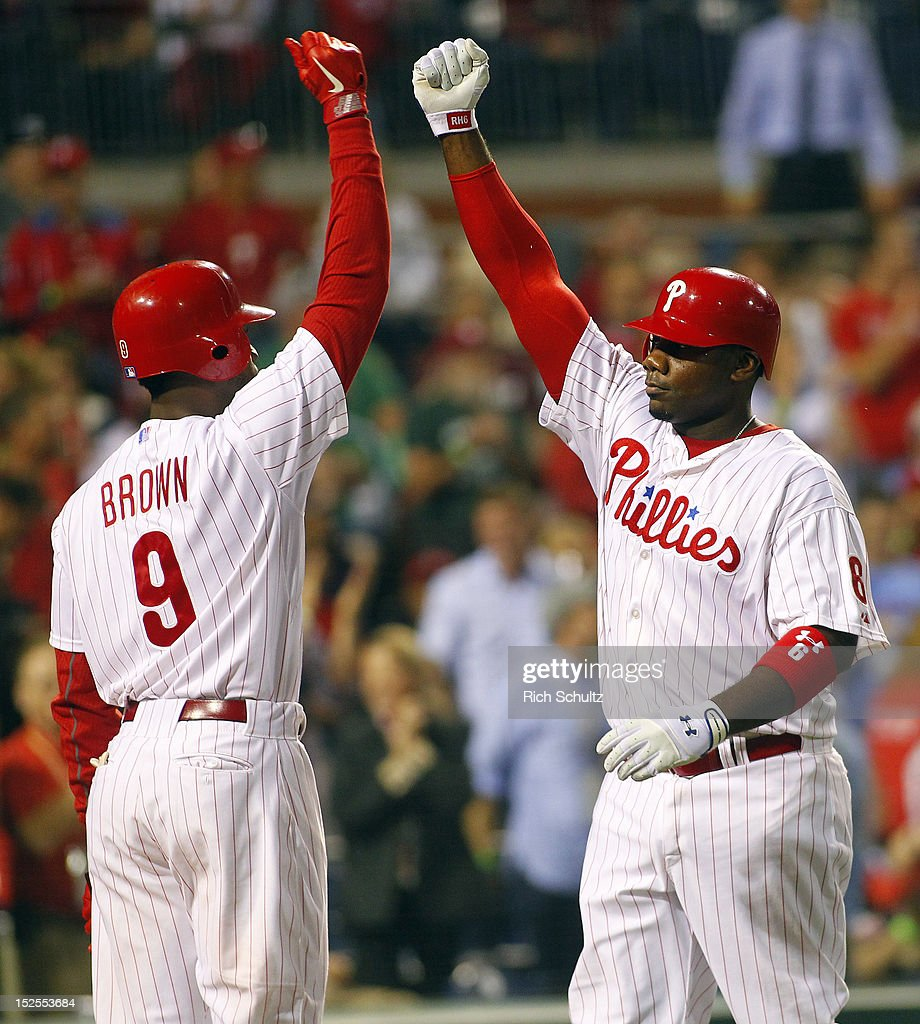 Ryan Howard #6 of the Philadelphia Phillies is congratulated by teammate Domonic Brown #9 after Howard's a solo-home run in the fourth inning against the Atlanta Braves during a MLB baseball game on September 21, 2012 at Citizens Bank Park in Philadelphia, Pennsylvania.