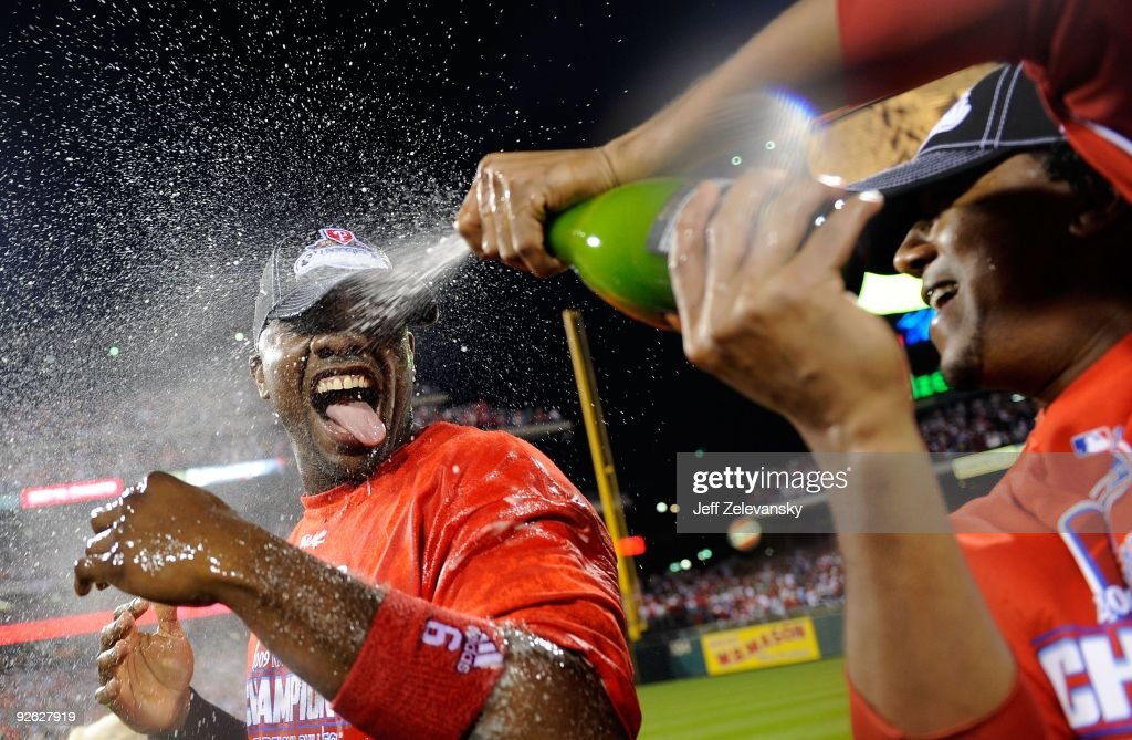 Ryan Howard #6 of the Philadelphia Phillies is sprayed down with champagne by teammate Pedro Martinez #45 as they celebrate defeating the Los Angeles Dodgers 10-4 to advance to the World Series in Game Five of the NLCS during the 2009 MLB Playoffs at Citizens Bank Park on October 21, 2009 in Philadelphia, Pennsylvania.
