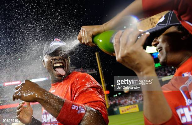 Ryan Howard of the Philadelphia Phillies is sprayed down with champagne by teammate Pedro Martinez as they celebrate defeating the Los Angeles...