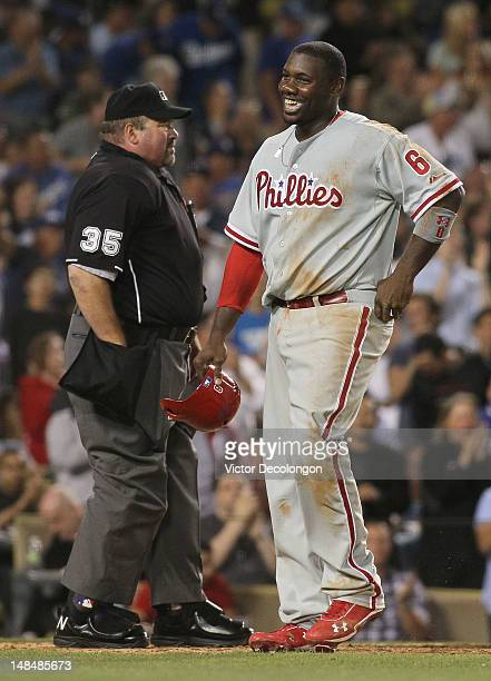 Ryan Howard of the Philadelphia Phillies laughs in disbelief after being called out on the play at homeplate by MLB home plate umpire Wally Bell in...