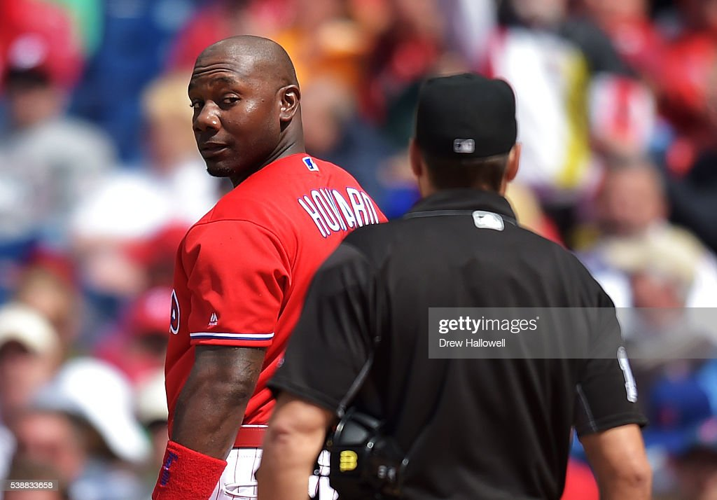 Ryan Howard #6 of the Philadelphia Phillies looks back at umpire Mark Wegner #14 after striking out in the seventh inning against the Chicago Cubs at Citizens Bank Park on June 8, 2016 in Philadelphia, Pennsylvania. The Cubs won 8-1.