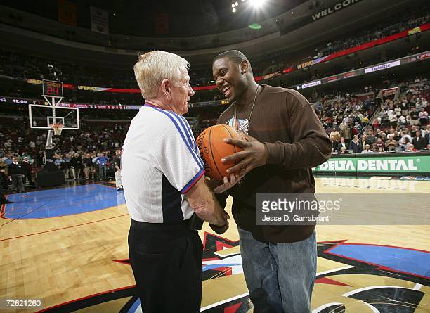 Ryan Howard of the Philadelphia Phillies presents the game ball to official Jess Kersey before the start of the game between the Philadelphia 76ers...