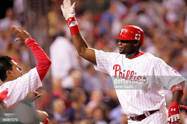Ryan Howard of the Philadelphia Phillies returns to the dugout after hitting a solo home run against the Atlanta Braves during the first inning on...