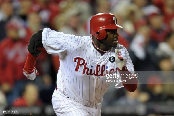 Ryan Howard of the Philadelphia Phillies runs after hitting a two-run RBI single in the first inning against the St. Louis Cardinals during Game Two...