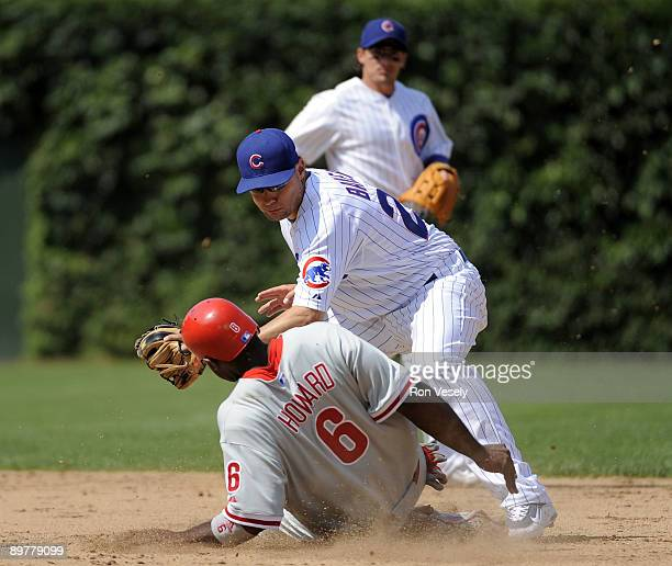 Ryan Howard of the Philadelphia Phillies steals second base against Jeff Baker of the Chicago Cubs at Wrigley Field August 13, 2009 in Chicago,...