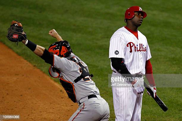 Ryan Howard of the Philadelphia Phillies strikes out to end the game and lose as Buster Posey of the San Francisco Giants celebrates in Game Six of...