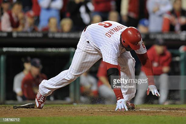 Ryan Howard of the Philadelphia Phillies stumbles as he runs out of the box on his ground out for the final out of the game as they lost 10 against...
