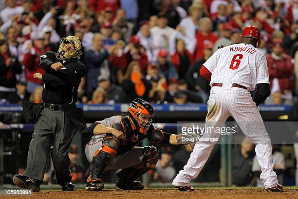 Ryan Howard of the Philadelphia Phillies takes a called third strike to end the game and lose to the San Francisco Giants in Game Six of the NLCS...