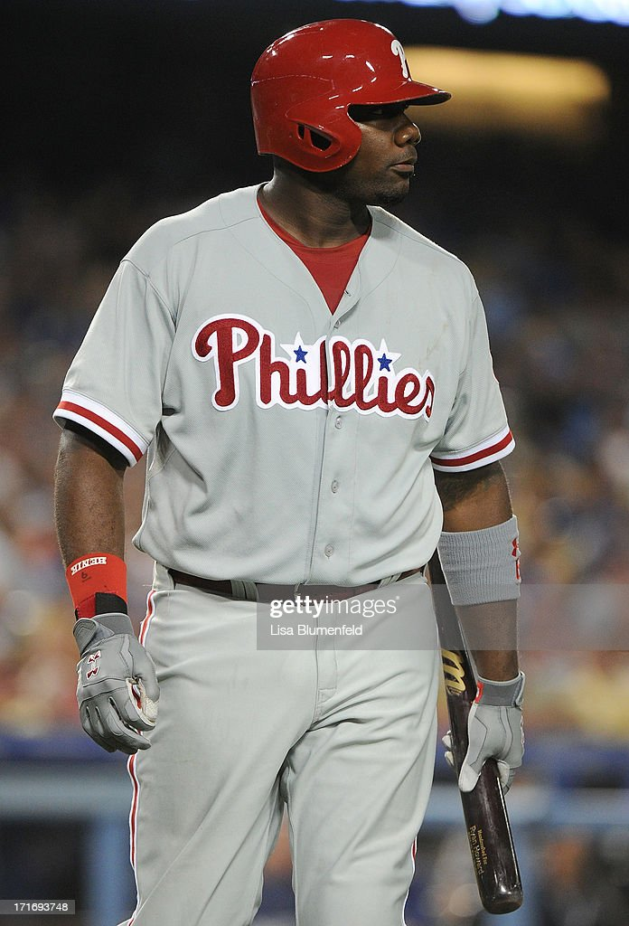 Ryan Howard #6 of the Philadelphia Phillies walks back to the dugout after striking out in the eighth inning against the Los Angeles Dodgers at Dodger Stadium on June 27, 2013 in Los Angeles, California.