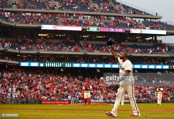 Ryan Howard of the Philadelphia Phillies waves to the crowd after being removed from the field during the ninth inning of a game against the New York...