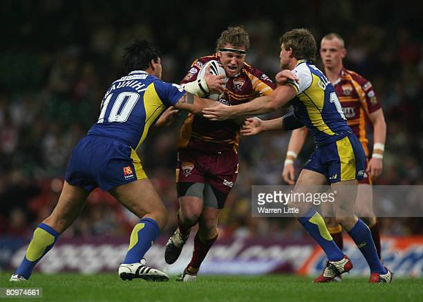 Ryan Hudson of Huddersfield is tackled by Paul Rauhihi and Martin Gleeson of Warrington during the engage Super League 'Millennium Magic' match...