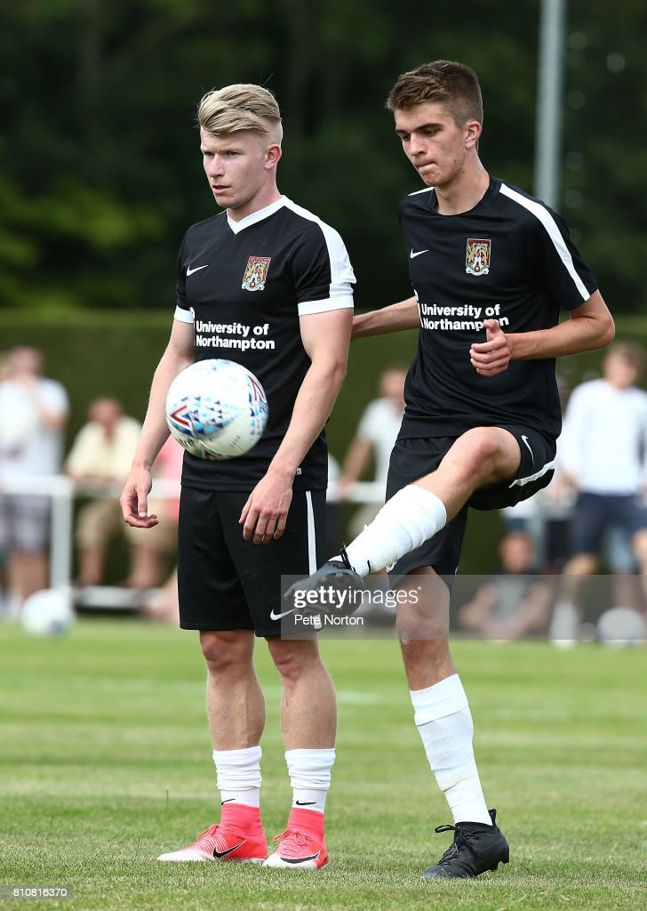 Ryan Hughes (right) and George Smith of Northampton Town warm up prior to the Pre-Season Friendly Match between Sileby Rangers and Northampton Town at Fernie Fields on July 8, 2017 in Northampton, England.
