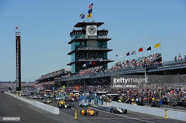 Ryan HunterReay driver of the Andretti Autosport Dallara Honda leads the field out of the pits during the 98th running of the Indianapolis 500 mile...