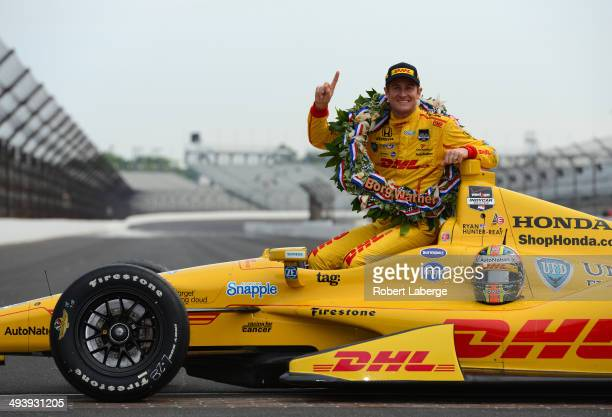 Ryan HunterReay driver of the Andretti Autosport Dallara Honda poses with the Borg Warner Trophy at the yard of bricks during the Indianapolis 500...