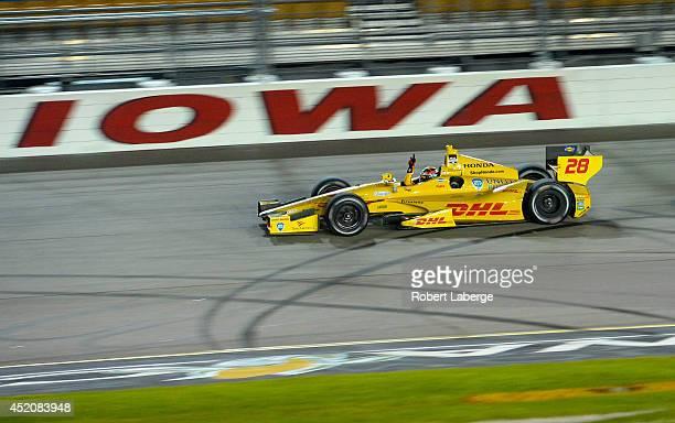 Ryan Hunter-Reay driver of the Andretti Autosport Dallara Honda crosses the finish line to win the Verizon IndyCar Series Iowa Corn Indy 300...