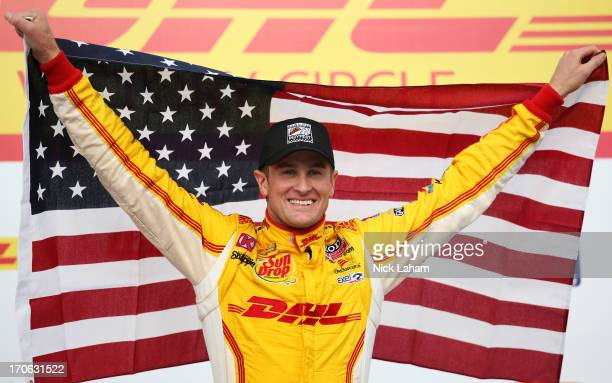 Ryan HunterReay driver of the Andretti Autosport DHL Chevrolet celebrates winning in victory lane during the Milwaukee IndyFest at the Milwaukee Mile...