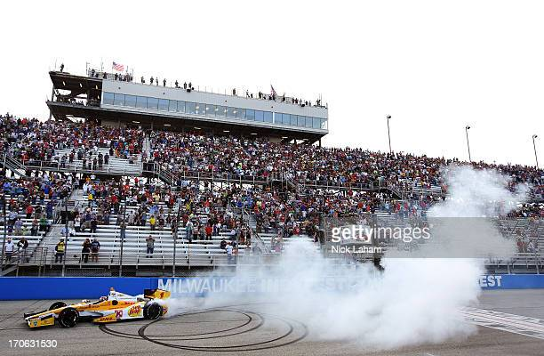 Ryan HunterReay driver of the Andretti Autosport DHL Chevrolet celebrates winning the Milwaukee IndyFest at the Milwaukee Mile on June 15 2013 in...