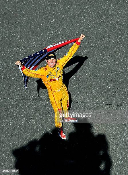 Ryan HunterReay driver of the Andretti Autosport DHL Honda looks skyward as he hoists the American Flag after winning the 98th running of the...