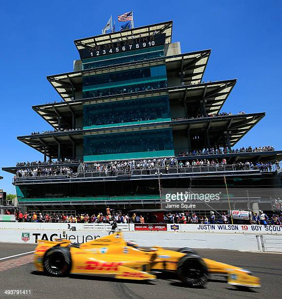 Ryan HunterReay driver of the Andretti Autosport DHL Honda passes the pagoda during the 98th running of the Indianapolis 500 Mile Race at...