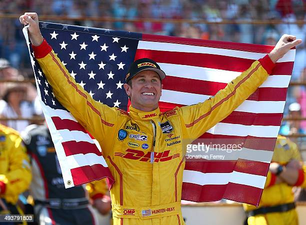 Ryan HunterReay driver of the DHL Andretti Autosport Chevrolet Dallara celebrates winning the 98th running of the Indianapolis 500 Mile Race on May...