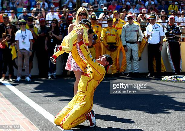 Ryan HunterReay driver of the DHL Andretti Autosport Honda Dallara celebrates with his son Ryden after winning the 98th running of the Indianapolis...
