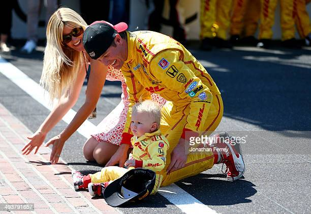 Ryan HunterReay driver of the DHL Andretti Autosport Honda Dallara celebrates with his son Ryden and wife Beccy after winning the 98th running of the...