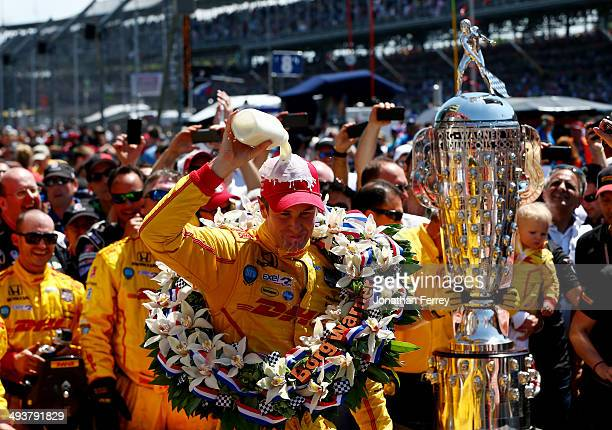 Ryan HunterReay driver of the DHL Andretti Autosport Honda Dallara celebrates in Victory Lane with milk after winning the 98th running of the...