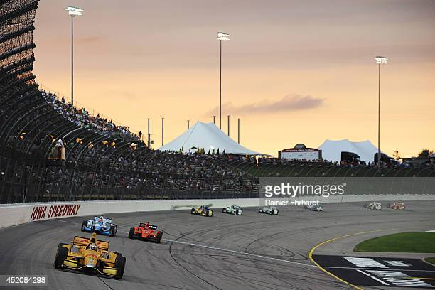 Ryan HunterReay driver of the DHL Andretti HVM Dallara Honda leads a pack of cars during the Iowa Corn Indy 300 at Iowa Speedway on July 12 2014 in...