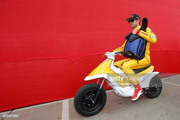 Ryan HunterReay driver of the DHL Dallara Honda rides a scooter prior to qualifying for the Verizon IndyCar Series Shell and Pennzoil Grand Prix Of...
