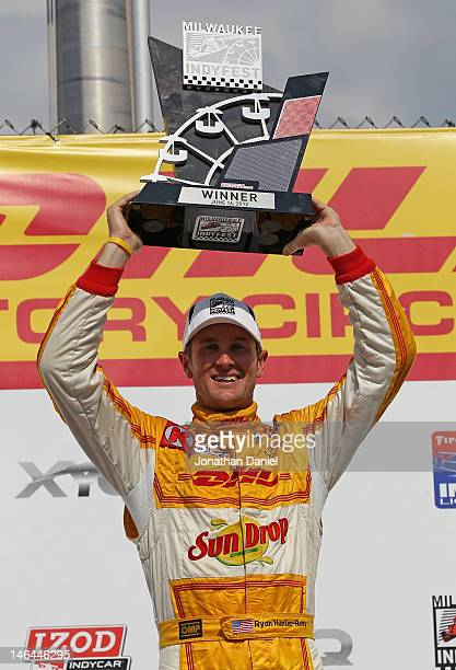 Ryan HunterReay driver of the Team DHL/Sun Drop Citrus Soda Andretti Autosport Chevrolet Dallara holds the first place trophy after winning the IZOD...