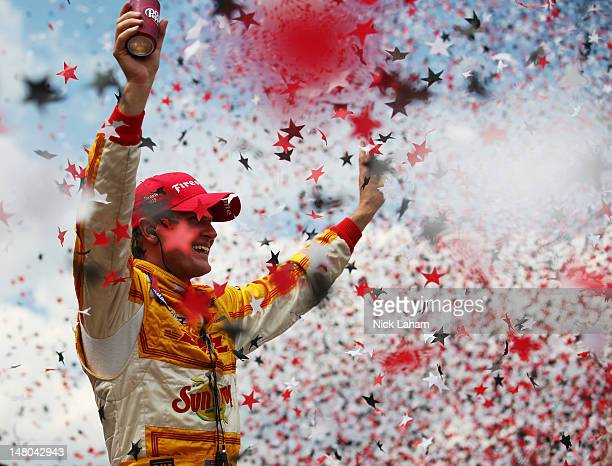 Ryan HunterReay driver of the Team DHL/Sun Drop Citrus Soda Chevrolet celebrates winning during the IZOD INDYCAR Series Honda Indy Toronto on July 8...