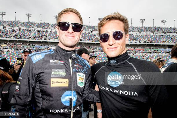 Ryan HunterReay L and Renger van der Zande are shown on the grid before the start of the Rolex 24 at Daytona at Daytona International Speedway on...