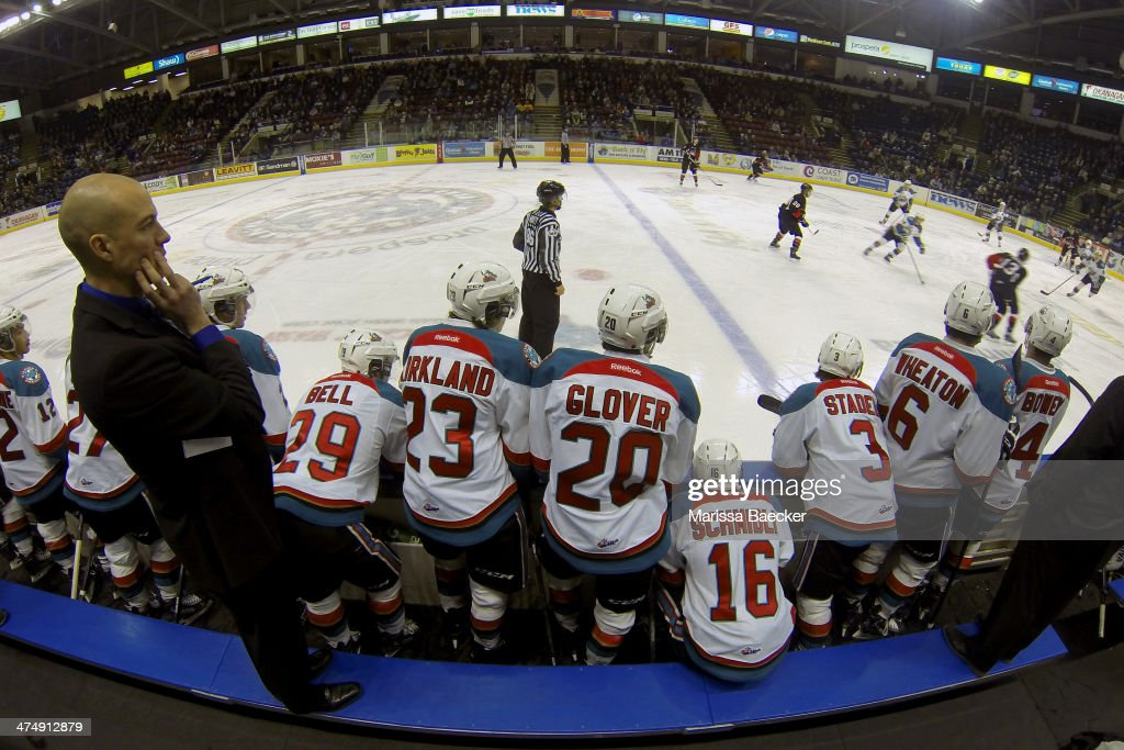 Ryan Huska, head coach of the Kelowna Rockets stands on the bench against the Prince George Cougars on February 25, 2014 at Prospera Place in Kelowna, British Columbia, Canada.