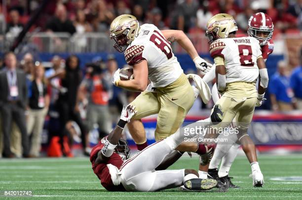 Ryan Izzo of the Florida State Seminoles runs after a catch against the Alabama Crimson Tide during their game at Mercedes-Benz Stadium on September...