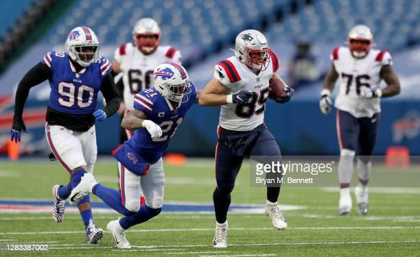 Ryan Izzo of the New England Patriots is chased by Quinton Jefferson of the Buffalo Bills Matt Milano of the Buffalo Bills during a game at Bills...