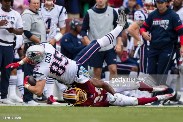 Ryan Izzo of the New England Patriots is tackled by Josh Norman of the Washington Redskins during the first half at FedExField on October 6, 2019 in...