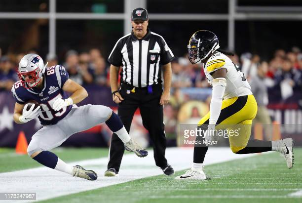 Ryan Izzo of the New England Patriots is tackled out of bounds by Devin Bush of the Pittsburgh Steelers during the second half at Gillette Stadium on...