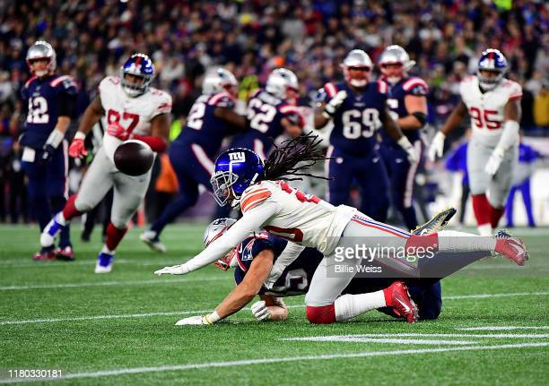 Ryan Izzo of the New England Patriots misses a catch against Janoris Jenkins of the New York Giants during the third quarter in the game at Gillette...