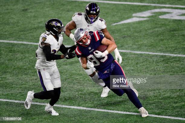 Ryan Izzo of the New England Patriots runs against the Baltimore Ravens during the first half at Gillette Stadium on November 15, 2020 in Foxborough,...
